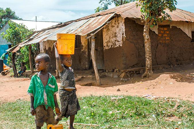 Water: Carrying the Burden - Children Carrying Water Buckets